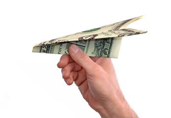 Lanzando avión de papel de billete de dólar.