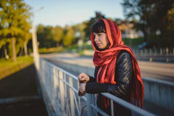 Girl in a scarf on the bridge