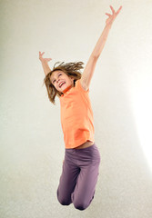 portrait of child  jumping and dancing