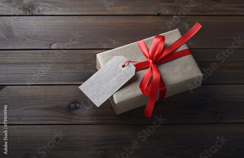 gift box with red ribbon - 79404946