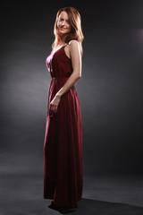 Elegant woman in long dress fashion model