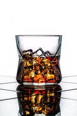 a stunning whiskey glass with ice - whiskey on the rocks
