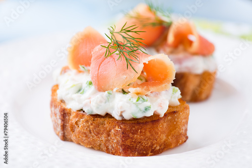 Fotobehang Voorgerecht Canapes with smoked salmon and cream cheese