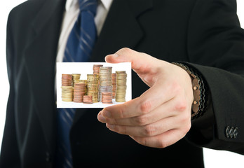 Businessman showing card with stack of euro coins