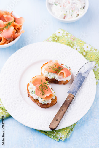 Fototapeta Canapes with smoked salmon and cream cheese