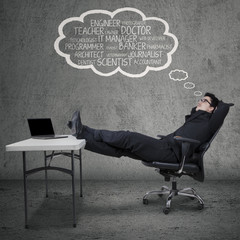 Businessman dreaming his future jobs