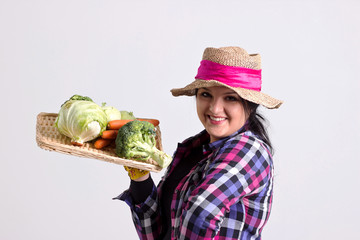 Smiling Garden Woman Holds a Tray of Vegetables