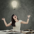 Happy student thought idea under lamp