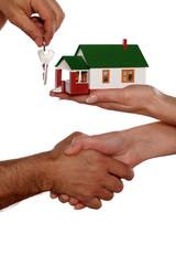 Miniature model house, key and handshaking