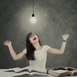 Smart student with lamp looks happy