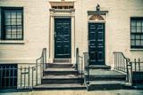 Fototapety Black doors on city apartment building