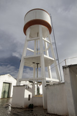Close up view of an old cement water reservation tower.