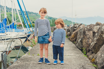 Two fashion kids playing in port