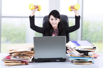 Woman working and exercising in office