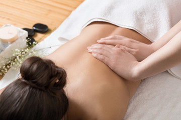 Woman Receiving Back Massage in Spa Center