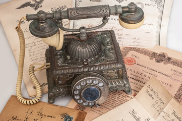 Old vintage telephone with ancient letters