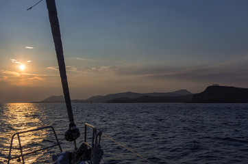 Sailing at dusk towards cape Sounio, Greece