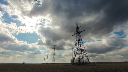 Clouds, electric pylons, sun, timelapse