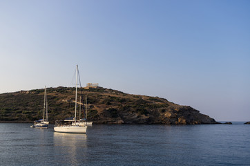 Sailing yachts under the ancient temple of Poseidon, Gre