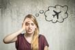 Leinwanddruck Bild - Junge Frau denkt an Flugzeug