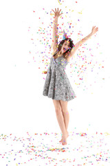 Happy woman raised hands with confetti