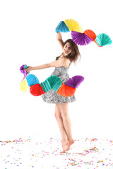 Beautiful woman dancing with paper party decorations