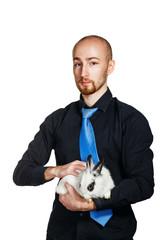 Businessman holding a rabbit