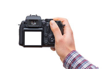 Male hand holding DSLR camera isolated on white