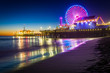 Leinwandbild Motiv The Santa Monica Pier at night, in Santa Monica, California.