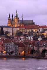 Prague gothic Castle with Charles Bridge after sunset