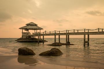 Bridge on beach in sunset and sea wave in Koh Kood , Thailand