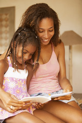 Happy African American Mother and Daughter Studying