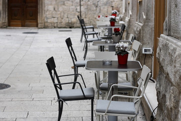 Charming little outdoor cafe in Old Town Split (Croatia).