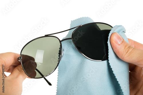 Fototapeta Person Cleaning Sunglasses