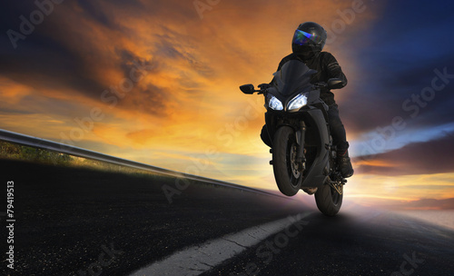 young man riding motorcycle on asphalt highways road with profes - 79419513