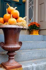 Pumpkins arranged in a large urn for seasonal display