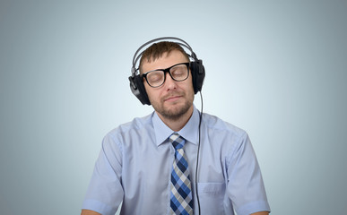 Happy bearded man listening to music with headphones