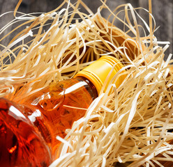 Bottle of whiskey in a wooden box. Close-up view