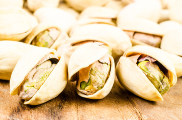 Close up of pistachio nut on wooden background