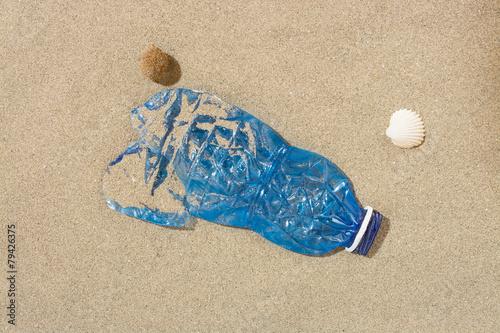 Plastic bottle on the beach - 79426375