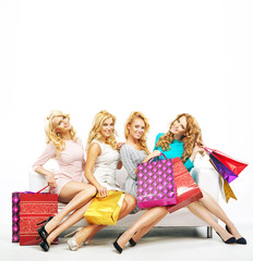 Four girlfriends with a lot of shoppings