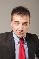 Upset young business man