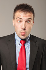 young business man making a funny face
