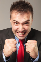 Furious business man making a angry face