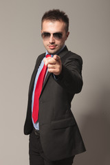Attractive young business man pointing