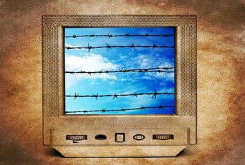 Old TV and barbwire concept