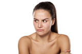 scowling dissatisfied young woman without makeup poster
