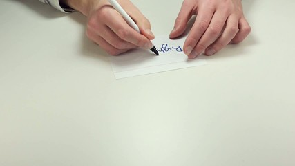 Man hands write the note Right Off