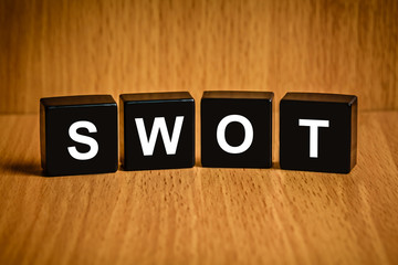 SWOT word on black block