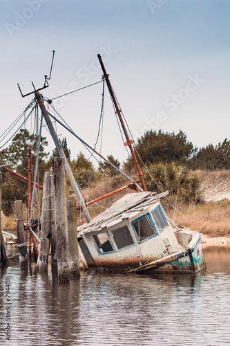 Wrecked shrimping boat half sunken - 79441111